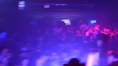 DJ plays at the disco, dancing people in the background - stock footage