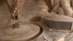 Millstones grinds corn Stock Footage
