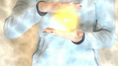magic glowing ball of yellow in female hands - stock footage