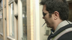 Man in Sunglasses Winks to Camera CU Stock Footage