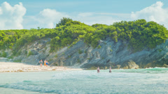 Vacationing People Swimming at a Bermudan Beach Stock Footage