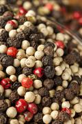 Raw whole four peppercorn blend Stock Photos