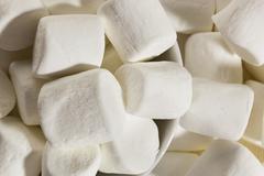Delicious white fluffy round marshmallows Stock Photos