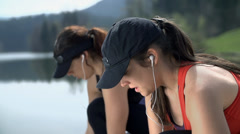 Two Girls Breathing And Preparing To Run Stock Footage
