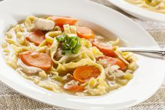 homemade organic chicken noodle soup - stock photo