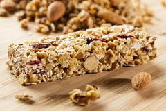 organic almond and raisin granola bar - stock photo