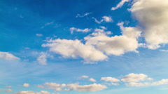 White clouds in the blue sky, 4k time-lapse Stock Footage