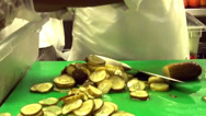 Stock Video Footage of Cook cutting cucumber