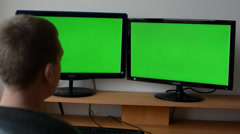 Man works on the computer - green screen - stock footage