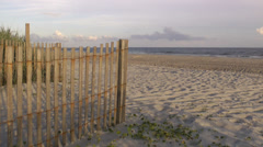North Carolina beach landscape including dune fence Stock Footage