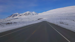 Driving Plate POV Yukon Mountain Roads in Snow Country Round Bend Stock Footage