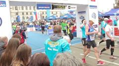 People running through finish line at half Marathon event Stock Footage