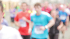 Defocused and detailed shot of people running at half Marathon event - stock footage