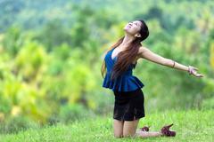 beautiful filipina woman rejoicing in nature - stock photo