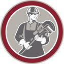 Stock Illustration of plumber holding giant wrench woodcut circle