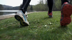 Close Up On Shoes Running On Grass in Slow Motion Stock Footage