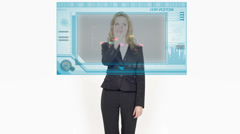 Smiling Businesswoman Using A Futuristic Graphic Hologram. Stock Footage