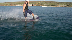 Slow-Mo: Wakeboarder Sliding On Rail Doing Trick Stock Footage