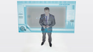 Stock Video Footage of Confident Businessman Checking Out Statistics On Hologram.