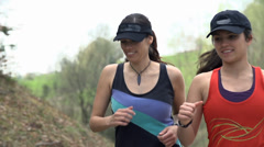 Two Girls Running Up Hill In Slow Motion Stock Footage