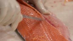 Cutting salmon fillet close up Stock Footage