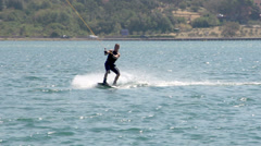 Slow-Mo: Wakeboarder Sinking Into Water Stock Footage