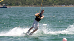 Slow-Mo: Brave Wakeboarder Carving Fast And Doing Flip Stock Footage