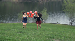 Two Girls Enjoying Life Running With Red Balloons In Dresses Stock Footage