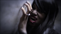 Female Vampire clawing the wall Stock Footage