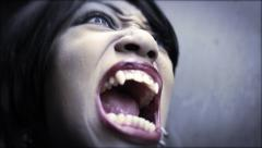 Female Vampire awakes dramatic tight close up Stock Footage