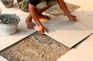 Stock Photo of floor tile installation for house building