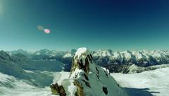Fly over mountain peak. snow winter landscape Stock Footage