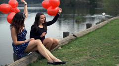 Slow Motion Two Girls With Red Balloons At Lake Stock Footage