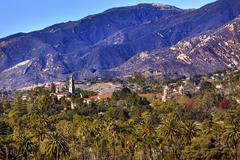 Mission santa barbara mountains palm trees california Stock Photos