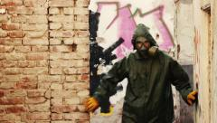 The man with gas mask and decontamination suit in abandoned buildings Stock Footage