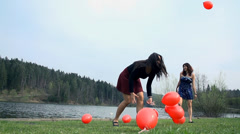 Young Girls In Dress Enjoying Life At Lake With Red Balloons Stock Footage