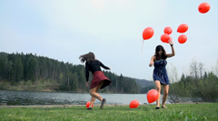 Throwing A lot Of Red Balloons In To Air In Nature Stock Footage