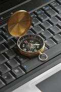 compass on the laptop - stock photo