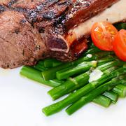 rack of lamb on grill with an asparagus - stock photo