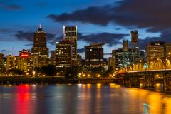 Nighttime portland skyline at willamette river waterfront with bridge Stock Photos