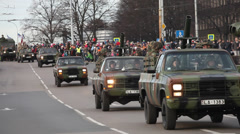 The Latvian National Armed Forces trucks participate in military Parade Stock Footage