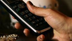 Woman is composing a number on a mobile phone: call, cellular, calling Stock Footage