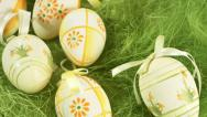 Stock Video Footage of Easter eggs on green grass, 4K