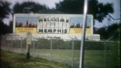 177 - welcome to Memphis & Arkansas billboard - vintage film home movie - stock footage