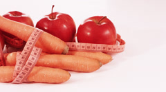 Red apples, carrots and measure tape, 4K - stock footage