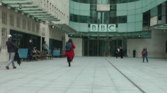 Bbc broadcasting house london passersby and film crew passing Stock Footage