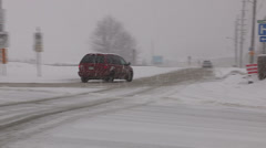 Cars sliding and crashing in snow storm in Barrie Ontario - stock footage