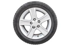 one car tire on white background - stock photo