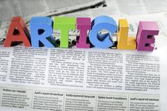 Word article on newspaper Stock Photos