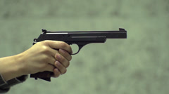 Girl Firing Pistol - Slow Motion  Stock Footage